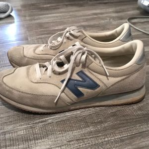 Navy and cream new balance sneakers
